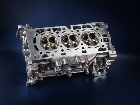 A cylinder head with an integrated exhaust manifold.