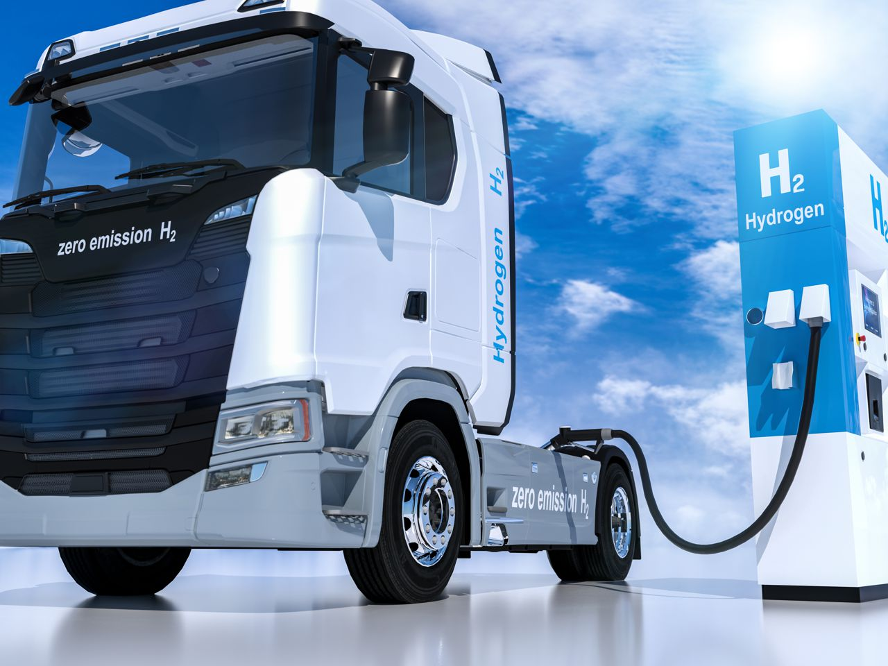 Truck at fuel filling station with hydrogen symbol